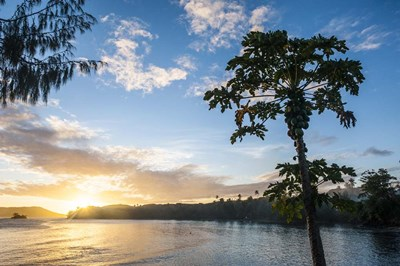 Sunset over the beach of resort, Nacula Island, Yasawa, Fiji, South Pacific art print by Michael Runkel / DanitaDelimont for $31.25 CAD
